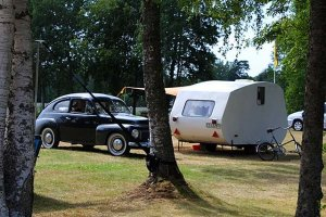 An old Volvo from the 50's with caravan